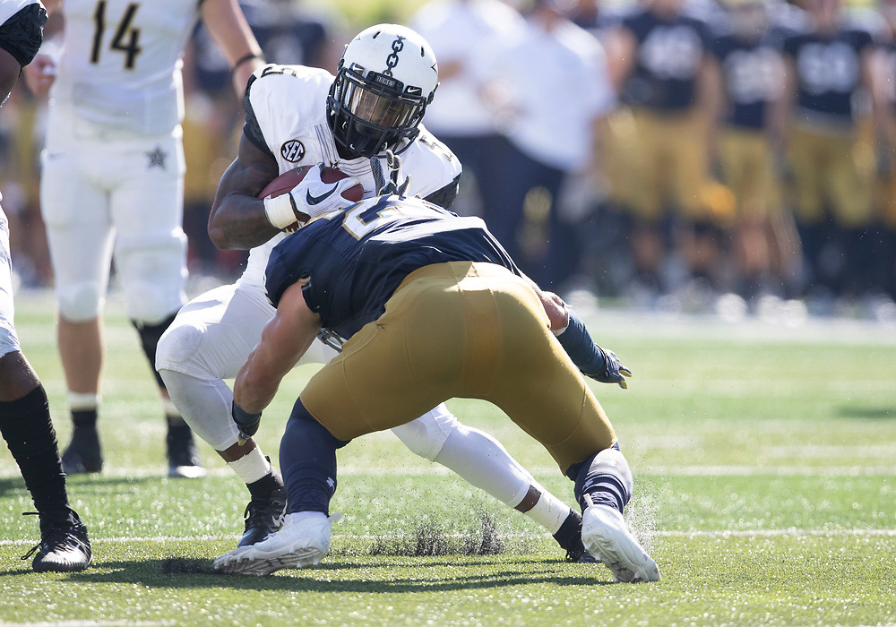 September 15, 2018:  Notre Dame linebacker Drue Tranquill (23) makes the tackle on Vanderbilt running back Ke'Shawn Vaughn (5) during NCAA football game action between the Vanderbilt Commodores and the Notre Dame Fighting Irish at Notre Dame Stadium in South Bend, Indiana.  Notre Dame defeated Vanderbilt 22-17.  John Mersits/CSM.