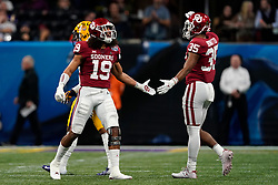 Caleb Kelly #19 reacts to a play with Nik Bonitto #35 of the Oklahoma Sooners during the first half against the LSU Tigers in the 2019 College Football Playoff Semifinal at the Chick-fil-A Peach Bowl on Saturday, Dec. 28, in Atlanta. (Paul Abell via Abell Images for the Chick-fil-A Peach Bowl)