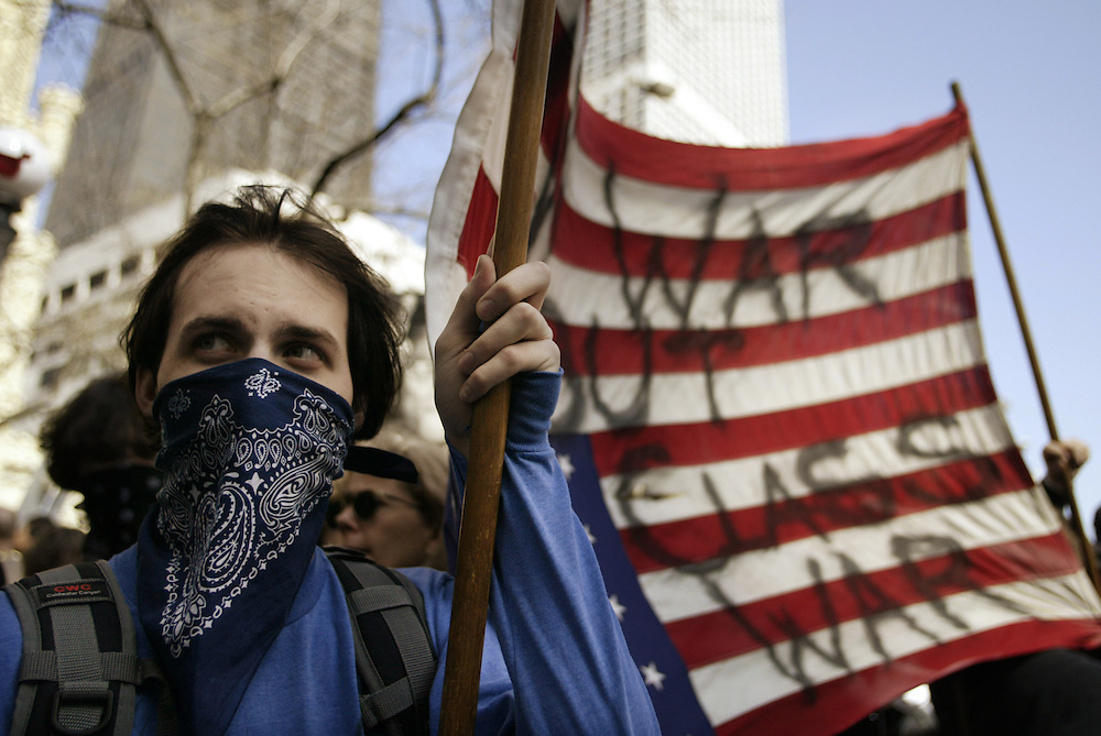 Anti-war protestors take to the streets in downtown Chicago Saturday afternoon contained by thousands of police dressed in riot gear.  The protest was to mark the first anniversary of the war in Iraq.