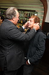 Left to right, SIR DAI LLEWELLYN and NICKY HASLAM at a party to celebrate the opening of Maze - a new Gordon Ramsay restaurant at 10-13 Grosvenor Square, London W1 on 24th May 2005.<br /><br />NON EXCLUSIVE - WORLD RIGHTS