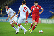 Gareth Bale of Wales (r). Euro 2012 Qualifying match, Wales v Montenegro at the Cardiff City Stadium in Cardiff  on Friday 2nd Sept 2011. Pic By  Andrew Orchard, Andrew Orchard sports photography,