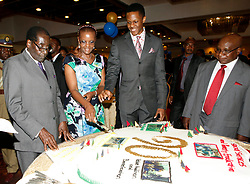 (140315) -- HARARE, March 15 (Xinhua) -- Zimbabwean President Robert Mugabe (1st,L), his wife Grace Mugabe (2nd,L) and their son Robert Mugabe Jr.(3rd,L) participate during a celebration for his 90th birthday organized by civil society, in Harare, capital of Zimbabwe, March 14, 2014. Born on Feb. 21, 1924, Mugabe is at the moment the oldest leader of all Africa. The presidential office, ruling Zanu-PF party, and civil society have separately organized three birthday celebrations for him since this February. (Xinhua/Stringer) (sss) (Photo by Xinhua/Sipa USA)