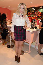 TV reporter POPPY JAMIE at the launch of the Benefit Global Flagship Boutique at 10 Carnaby Street, London on 11th September 2013.