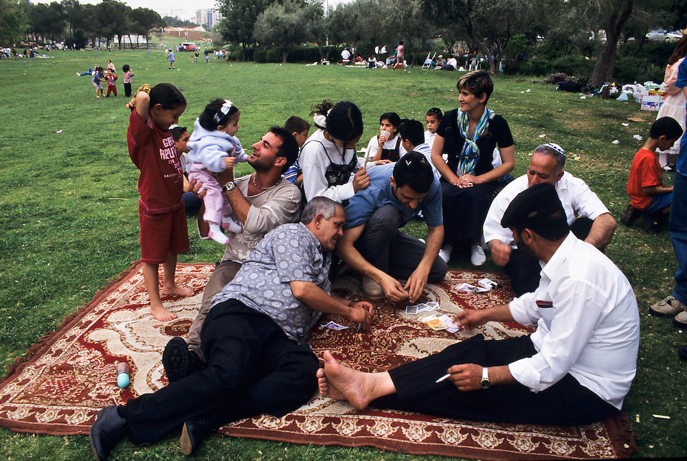A Jewish family enjoying the outdoors in a park in Jerusalem.
