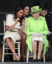 Queen Elizabeth II and the Duchess of Sussex at the opening of the new Mersey Gateway Bridge, in Widnes, Cheshire. In the background is Samantha Cohen, the Queen's former Assistant Private Secretary who is now working with the Duchess.