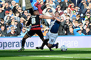 Birmingham City defender Paul Caddis is fouled by Queens Park Rangers midfielder Tjarron Chery during the Sky Bet Championship match between Birmingham City and Queens Park Rangers at St Andrews, Birmingham, England on 17 October 2015. Photo by Alan Franklin.