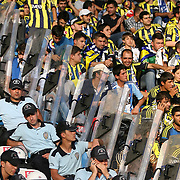 Fenerbahce's supporters with police security during their Turkish Super Cup 2012 soccer derby match Galatasaray between Fenerbahce at the Kazim Karabekir stadium in Erzurum Turkey on Sunday, 12 August 2012. Photo by TURKPIX