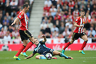 Sunderland defender John O'Shea (16)  just beats Middlesbrough midfielder Stewart Downing (19)  to the ball during the Premier League match between Sunderland and Middlesbrough at the Stadium Of Light, Sunderland, England on 21 August 2016. Photo by Simon Davies.