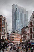 office building in liverpool street and spitafields, East London at lunchtime with dark clouds