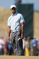 Golf - 2013 Open Championship at Muirfield - Friday Round Two<br /> Tiger Woods of USA rues a missed shot on the hole on the 5th