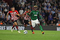 Football - 2018 / 2019 Premier League - Southampton vs. Brighton and Hove Albion<br /> <br /> Yves Bissouma of Brighton and Southampton's Mario Lemina tussle for the ball at St Mary's Stadium Southampton<br /> <br /> COLORSPORT/SHAUN BOGGUST