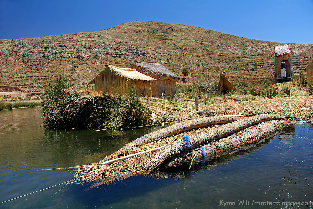 South America, Bolivia, Lake Titicaca. Floating reed island and boat of Lake Titicaca.