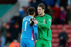 Asmir Begovic of Stoke City is congratulated by Lukasz Fabianski of Swansea City afte Stoke City win 2-1 - Photo mandatory by-line: Rogan Thomson/JMP - 07966 386802 - 19/10/2014 - SPORT - FOOTBALL - Stoke-on-Trent, England - Britannia Stadium - Stoke City v Swansea City - Barclays Premier League.