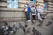 Family laughing at some hungry pigeons which they have been feeding french fries to. The South Bank is a significant arts and entertainment district, and home to an endless list of activities for Londoners, visitors and tourists alike.