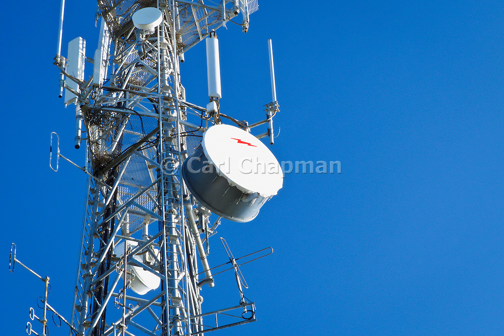 Microwave dish antenna on telecom communications tower for the cellular telephone system. <br /> <br /> Editions:- Open Edition Print / Stock Image
