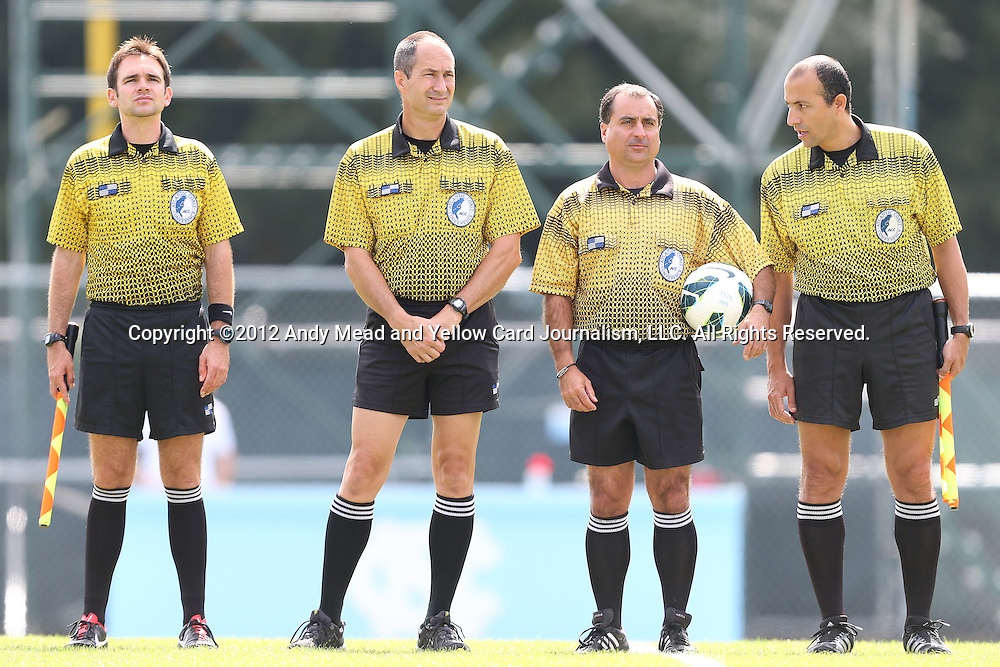 30 September 2012: Match officials. From left: Assistant referee Jeremy Smith, Fourth Official Dan Dunbar, Referee Robert Grenus, Assistant referee Saeed Mohamed. The University of North Carolina Tar Heels defeated the University of Miami Hurricanes 6-1 at Fetzer Field in Chapel Hill, North Carolina in a 2012 NCAA Division I Women's Soccer game.