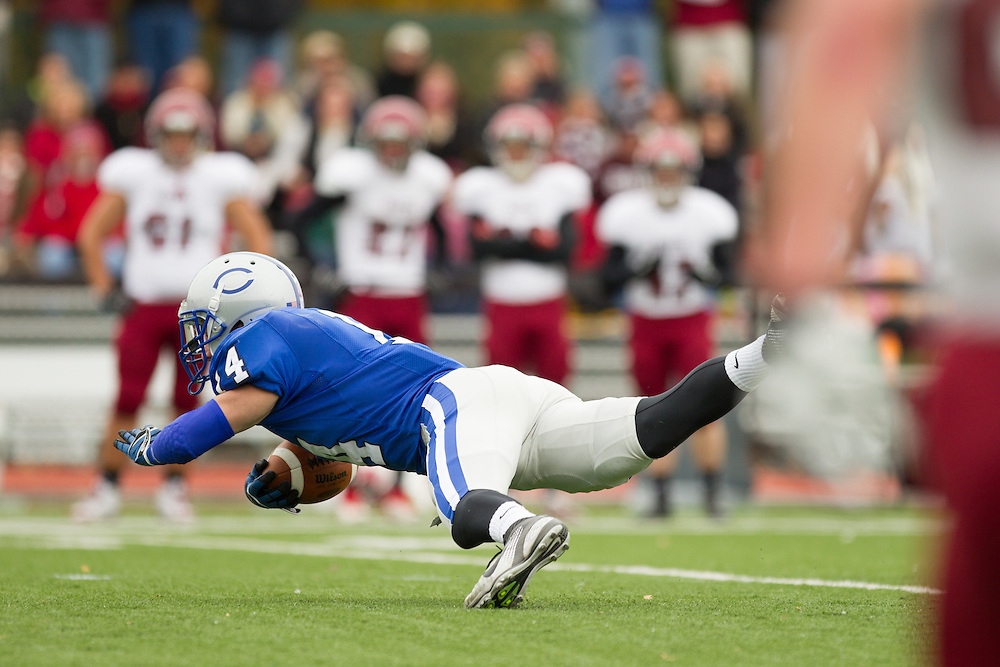 Jason Buco, of Colby College, intercepts a pass in a NCAA Division III football game against Bates College on October 26, 2013 in Waterville, ME. (Dustin Satloff/Colby College Athletics)