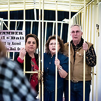 State Rep. Patty Lundstrum, left, Gallup City Council Linda Garcia and County Commissioner Billy Moore get locked up in jail at the Gallup-McKinley County Chamber of Commerce Banquet Friday evening.