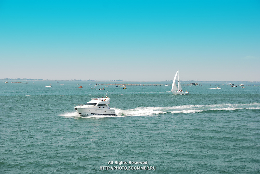 White yacht in the sea going at high speed