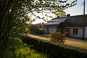 A rural bungalow and its walled boundary, on 5th May 2018, in Wrington, North Somerset, England.