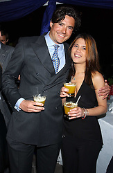 EDWARD TAYLOR and CHRISTIANNE MOUTTET at a Conservative Party Reception for the Art held at 24 Thurloe Square, Lndon SW7 on 5th April 2005.<br /><br />NON EXCLUSIVE - WORLD RIGHTS