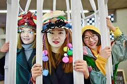 """© Licensed to London News Pictures. 15/01/2018. LONDON, UK. Zongxiu Xie, Yiwei Shi and Yuxuan Wang present """"Birdcage - Zootudio"""".  Students from Central Saint Martins, UAL, take part in the opening of Studio Complex, the second year of the Tate Exchange Associates programme at Tate Modern, presenting interactive works examining what it takes to survive as an artist in contemporary London.  Studio Complex runs 15 to 21 January. Photo credit: Stephen Chung/LNP"""