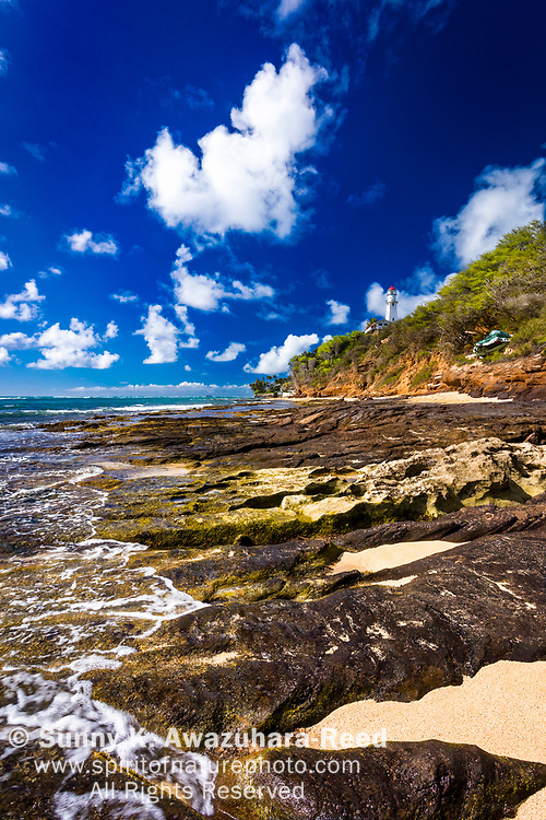 Diamond Head Lighthouse and Diamond Head Beach Park under blue sky, Honolulu, Oahu Island, Hawaii.