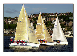 Yachting- The start of the Bell Lawrie Scottish series 2002 at Gourock racing overnight to Tarbert Loch Fyne where racing continues over the weekend.<br /><br />2 Sassy sunfast 37 IRL3702, Salamander XVI Elan 333 3335C and Tartan Revolution GBR9203R at the class 3  start.<br /><br />Pics Marc Turner / PFM