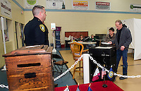 Lieutenant Kris Kelley looks on as Claire and Kerry Morrison place their ballot into the ballot box at the Gilford Community Center for Tuesday's NH Primary.  (Karen Bobotas/for the Laconia Daily Sun)