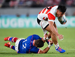 Japan's Ryoto Nakamura evades the tackle of Russia's Dmitry Gerasimov during the Pool A match between Japan and Russia at the Tokyo Stadium, Tokyo, Japan. Picture date: Friday September 20, 2019. See PA story RUGBYU Japan. Photo credit should read: Ashley Western/PA Wire. RESTRICTIONS: Editorial use only. Strictly no commercial use or association. Still image use only. Use implies acceptance of RWC 2019 T&Cs (in particular Section 5 of RWC 2019 T&Cs) at: https://bit.ly/2knOId6