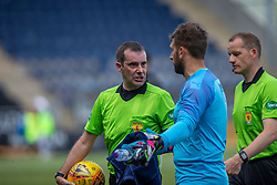 Falkirk's keeper Cammy Bell argues with Ref Alan Miuir about Livingston's goal. half time : Falkirk 0 v 1 Livingston, BetFred Cup game played 13/7/2019 at The Falkirk Stadium.