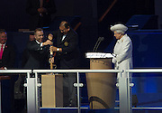 23.07.2014. Glasgow, Scotland. Glasgow Commonwealth Games. Fans ahead of the opening ceremony. Sir Chris Hoy  helps President of the CGF HRH Prince Imran with the Queens Baton