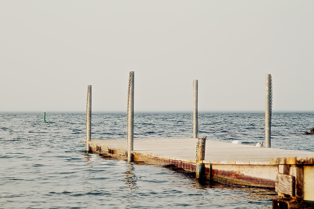 A pier reaches out to sea in the Beach neighbourhood of Toronto, Canada