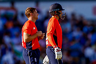 England T20 wicket keeper Jos Butler and England T20 batsman Joe Root watch the review but England T20 batsman Joe Root is given out during the International T20 match between England and India at Old Trafford, Manchester, England on 3 July 2018. Picture by Simon Davies.