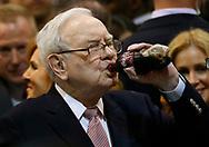 Berkshire Hathaway CEO Warren Buffett enjoys his favorite beverage, cherry Coke, before the Berkshire Hathaway annual meeting in Omaha, Nebraska, U.S. May 6, 2017. REUTERS/Rick Wilking