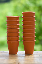 Tower of small terracotta pots
