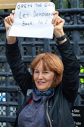 "Protester Pat, a woman in her ""late fifties"" from North London demands that Parliament open its gates and lets democracy back in. London, September 24 2019."