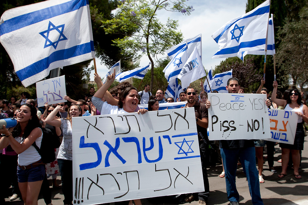 Israeli students demonstrate in support of Israel following the Israeli navy raid on an aid flotilla bound for the blockaded Gaza Strip, outside the Hebrew University in Jerusalem, on June 1, 2010.