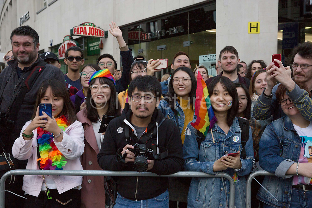 Tourists enjoy watching the Manchester Pride Parade pass St Peters Square on the 25th August 2018 in Manchester in the United Kingdom. The Manchester Pride is an annual LGBT pride festival and parade held each summer in the city of Manchester, England.