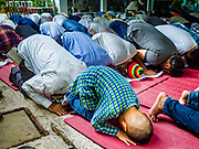 25 JUNE 2017 - BANGKOK, THAILAND: Men participate in Eid al-Fitr prayers at Ton Son Mosque. Eid al-Fitr is also called Feast of Breaking the Fast, the Sugar Feast, Bayram (Bajram), the Sweet Festival or Hari Raya Puasa and the Lesser Eid. It is an important Muslim religious holiday that marks the end of Ramadan, the Islamic holy month of fasting. Muslims are not allowed to fast on Eid. The holiday celebrates the conclusion of the 29 or 30 days of dawn-to-sunset fasting Muslims do during the month of Ramadan. Islam is the second largest religion in Thailand. Government sources say about 5% of Thais are Muslim, many in the Muslim community say the number is closer to 10%.    PHOTO BY JACK KURTZ