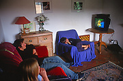 A293H8 Children watching television in their living room at home