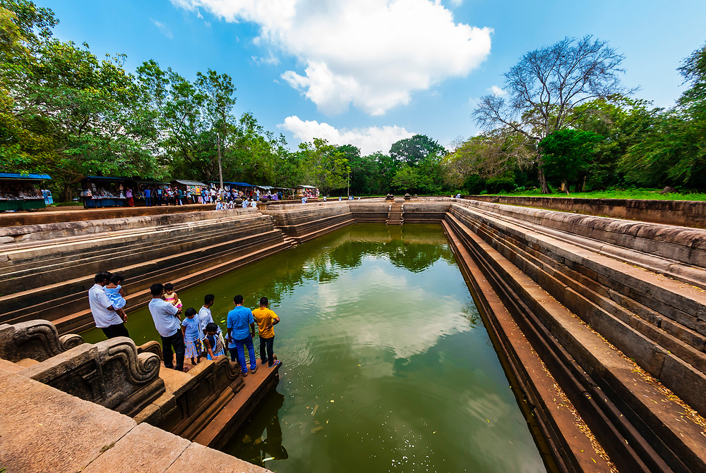 Water tank, Anuradhapura, Sri Lanka. Anuradhapura is one of the ancient capitals of Sri Lanka, famous for its well-preserved ruins of an ancient Sri Lankan civilization.