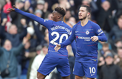 Chelsea's Eden Hazard (right) celebrates with Callum Hudson-Odoi (left) after scoring his sides first goal of the game during the Premier League match at Stamford Bridge, London.