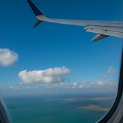 Airplane window view leaving Grand Cayman