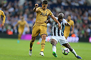 Allan Nyom of West Bromwich Albion ®  holds off Erik Lamela of Tottenham Hotspur .Premier league match, West Bromwich Albion v Tottenham Hotspur at the Hawthorns stadium in West Bromwich, Midlands on Saturday 15th October 2016. pic by Andrew Orchard, Andrew Orchard sports photography.