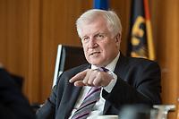 20 JUN 2018, BERLIN/GERMANY:<br /> Horst Seehofer, CSU, Bundesinnenminister, waehrend einem Interview, in seinem Buero, Bundesministerium des Inneren<br /> IMAGE: 20180620-02-023<br /> KEYWORDS: Büro