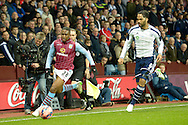 Charles N'Zogbia of Aston Villa is chased by Joleon Lescott of West Bromwich Albion. The FA cup, 6th round match, Aston Villa v West Bromwich Albion at Villa Park in Birmingham, Midlands on Saturday 7th March 2015<br /> pic by John Patrick Fletcher, Andrew Orchard sports photography.