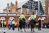 Police on horseback guide the fans outside Craven Cottage. EFL Skybet championship match, Fulham v Middlesbrough at Craven Cottage in London on Saturday 23rd September 2017<br /> pic by Steffan Bowen, Andrew Orchard sports photography.