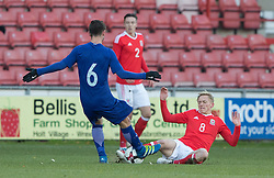 WREXHAM, WALES - Thursday, November 10, 2016: Wales' Matthew Smith in action against Stathis Lamprou ofGreece during the UEFA European Under-19 Championship Qualifying Round Group 6 match at the Racecourse Ground. (Pic by Gavin Trafford/Propaganda)
