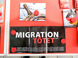 May 2, 2019 - Munich, Bavaria, Germany - ''Migration Kills'' under a postcard for neonazi Udo Voigt.  The neonazi NPD party organized an information table in one of the most-traveled districts of Munich- the pedestrian zone in the city center where shoppers, tourists and workers cross.  Behind the table was Munich city councilman Karl Richter, part of the neonazi group Buergerinitiativ Auslaender Stopp (Citizen Initiative to Stopp Foreigners) and Renate Werlberger of the NPD.  Both parties are widely accepted as being one and the same and confirmed by Richter in terms of ideology and membership.  The duo also displayed placards with ''Migration Kills'', deemed in the state of Saxony to be incitement.  Police refused to take a report to pass to the prosecutor. The pair were later joined by Heinz Meyer of Pegida Munich, who has been under federal terrorism monitoring since 2012. (Credit Image: © Sachelle Babbar/ZUMA Wire)